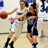 """Vista PEAK's Nicole Doherty (22) reaches in as Longmont's Kathryn Schell (23) dibbles around a screen from teammate Dailyn Johnson (34) during the game at Longmont High School on Tuesday, Feb. 26, 2013. Longmont beat Vista PEAK 65-18. For more photos visit  <a href=""""http://www.BoCoPreps.com"""">http://www.BoCoPreps.com</a>.<br /> (Greg Lindstrom/Times-Call)"""