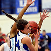 """Longmont's Dailyn Johnson grabs a rebound as Vista PEAK's Jaylynn Johnson defends during the game at Longmont High School on Tuesday, Feb. 26, 2013. Longmont beat Vista PEAK 65-18. For more photos visit  <a href=""""http://www.BoCoPreps.com"""">http://www.BoCoPreps.com</a>.<br /> (Greg Lindstrom/Times-Call)"""