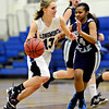 """Longmont's Grace Hamm (13) drives past Vista PEAK's Malia Kennedy (14) during the game at Longmont High School on Tuesday, Feb. 26, 2013. Longmont beat Vista PEAK 65-18. For more photos visit  <a href=""""http://www.BoCoPreps.com"""">http://www.BoCoPreps.com</a>.<br /> (Greg Lindstrom/Times-Call)"""