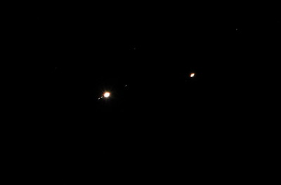 Jupiter (at the left) and Saturn in conjunction. Enlarged portion of the original image. Photographed with Sony a6600 @ 360 mm.  One second exposure at ISO 1600.
