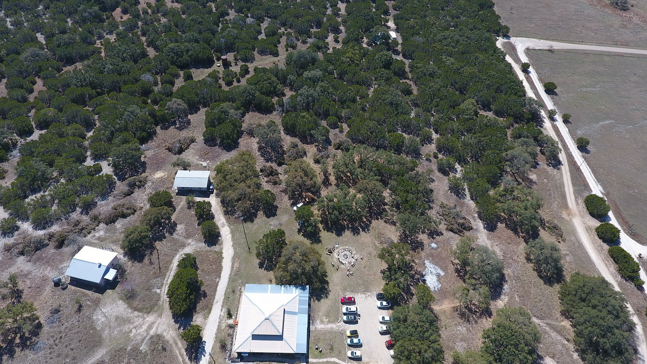 Aerial shot of the fire circle, meetinghouse and outbuildings