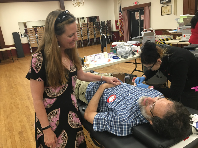 Pam Duchane of Billerica kept her husband company as he donated blood. Photo by Mary Leach