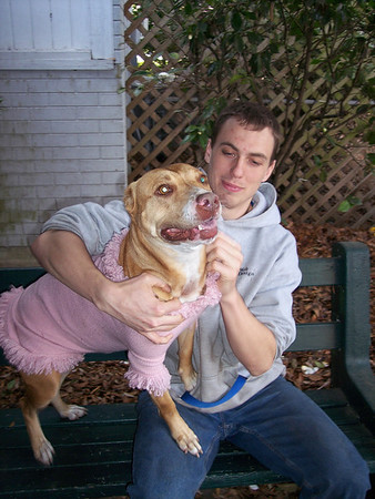 Mike O'Connell with Hope (now Bella) outside the left side of the breezeway, on our get acquainted bench