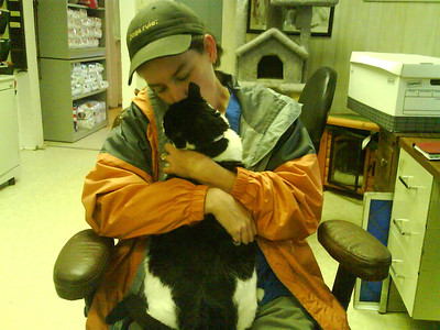 Kristin Kifer snuggling with January in the office at 1430