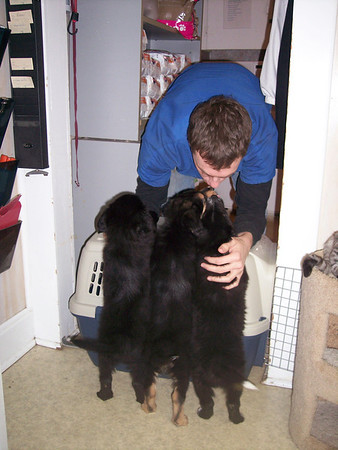 Mike O'Connell giving smoochies to Squeakers, Sophia, and Watty (he fostered Sophia and Squeakers)