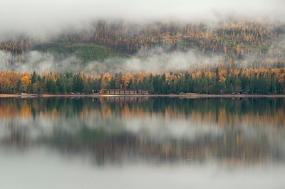 The Inn, Larch and clouds reflect off Lake McDonald