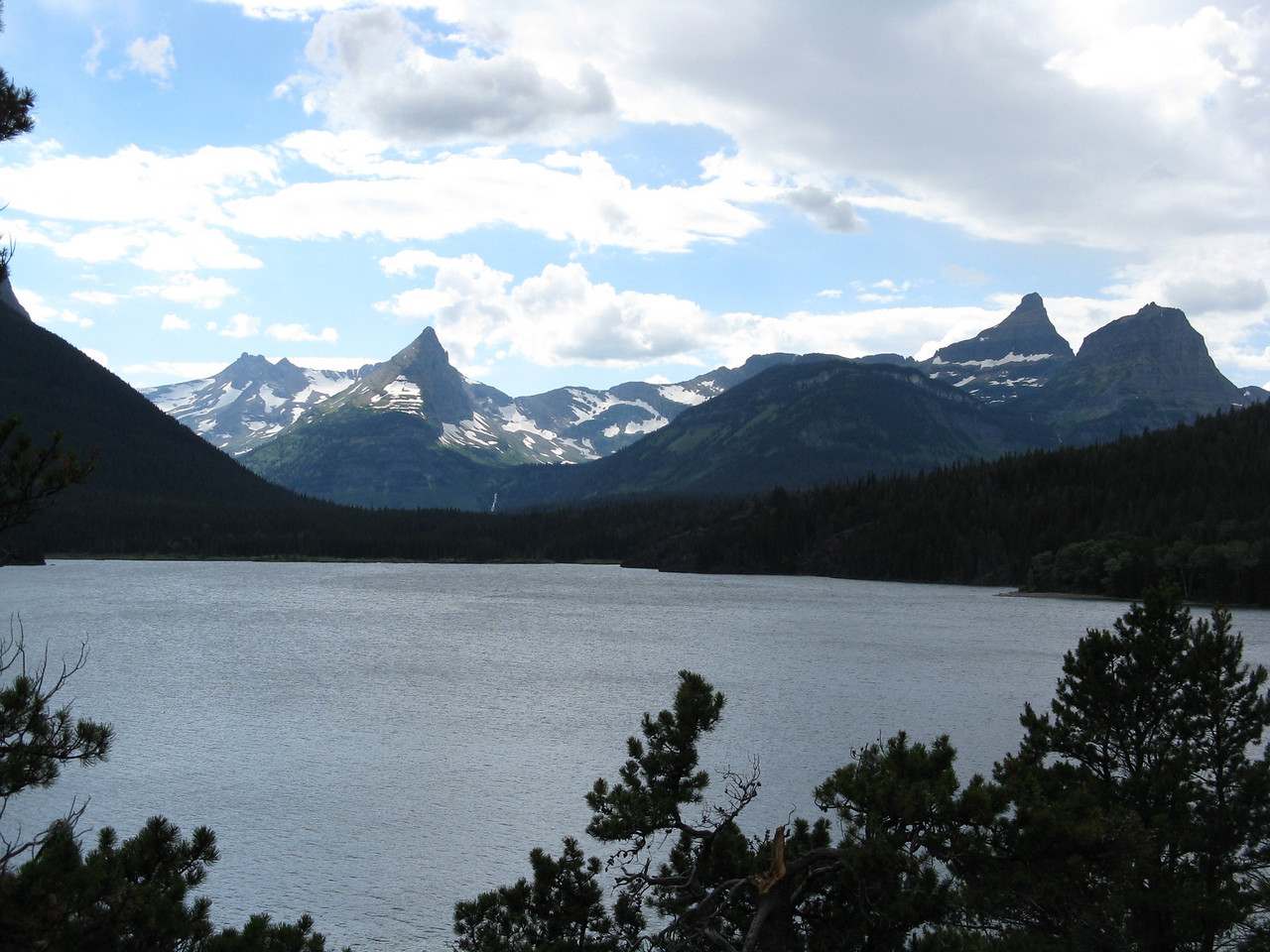 The last 9 miles or so of the road runs along Saint Mary Lake.  Here we are looking back towards the headwaters of the lake and towards Logan Pass.  I'm not sure of the names of the two pointed peaks in the distance.