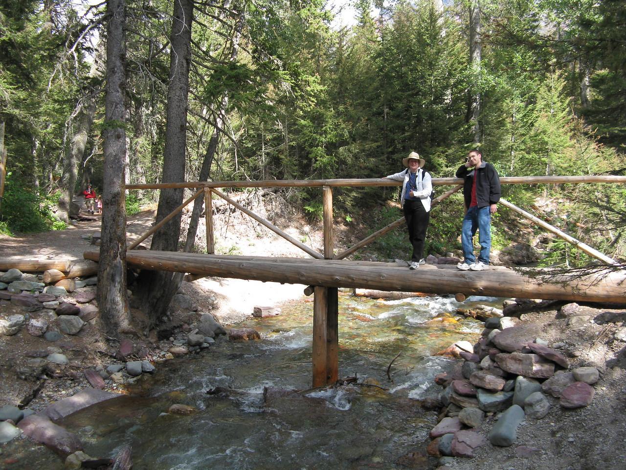 The creek and bridge below Baring Falls.  Mary and Kevin.