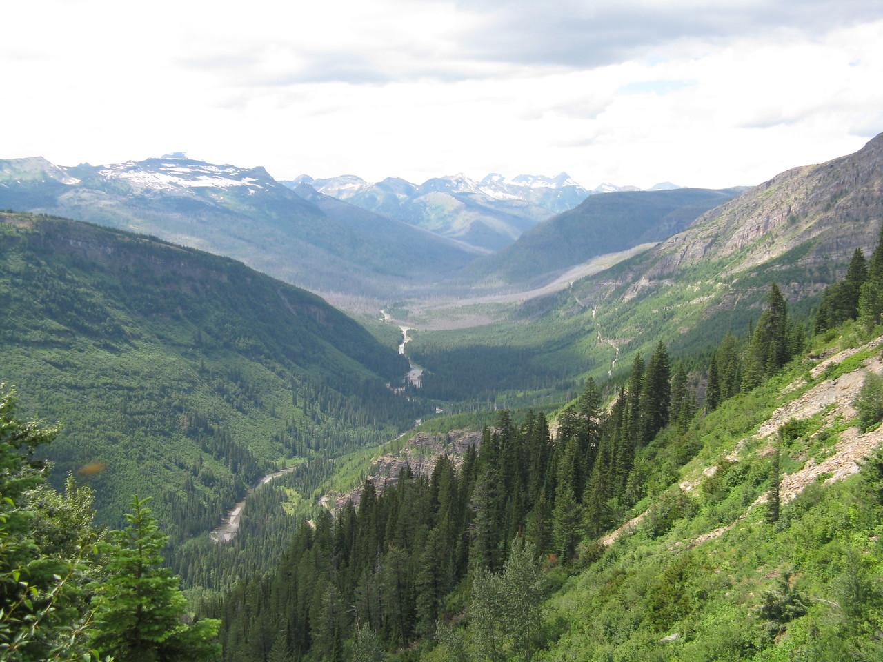 A wide angle view of the valley with snow on the distant mountains.