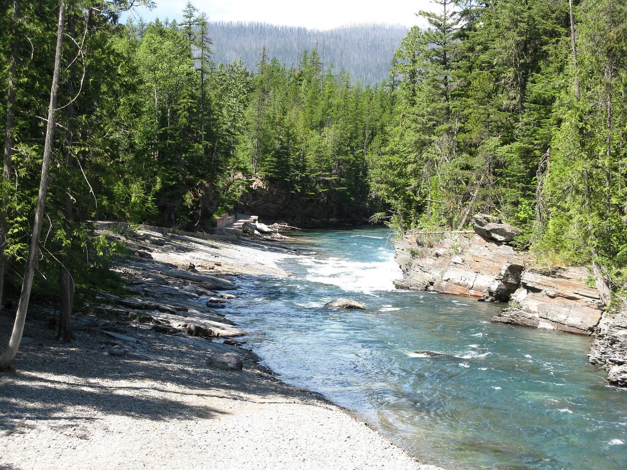A downstream, westward view from the bridge below McDonald Falls.