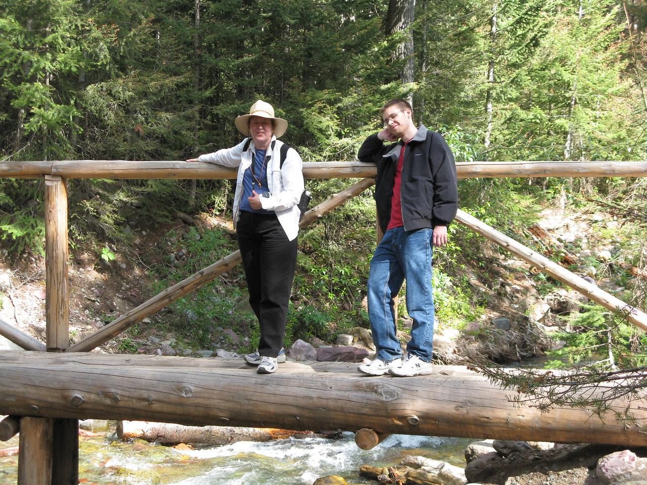 Mary and Kevin on the narrow log bridge.