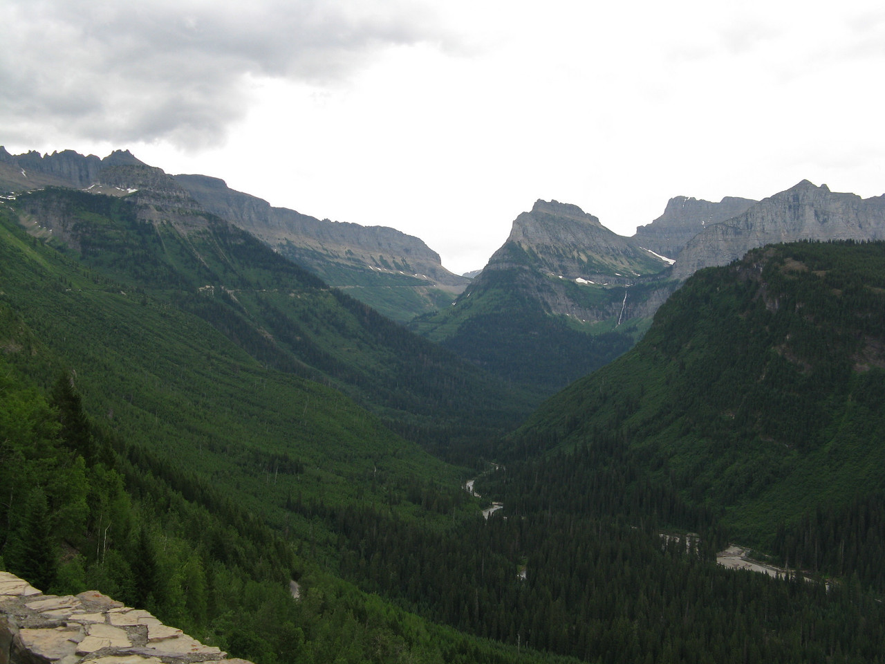 At about mile 23, we can see Logan Pass, which is the gap in the ridge in the distance.  The road runs along the mountainside on the left side of the picture.  These pictures drasticly understate the grandeur of the mountains in Glacier National Park.