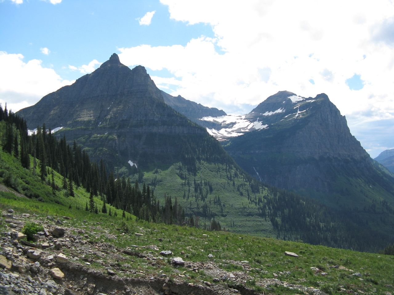 Closer to the pass at about mile 28, Hidden Valley and Hidden Lake lies in between Reynolds Mountain on the left and Bearhat Mountain on the right.  Logan pass is out of the image on the left side.