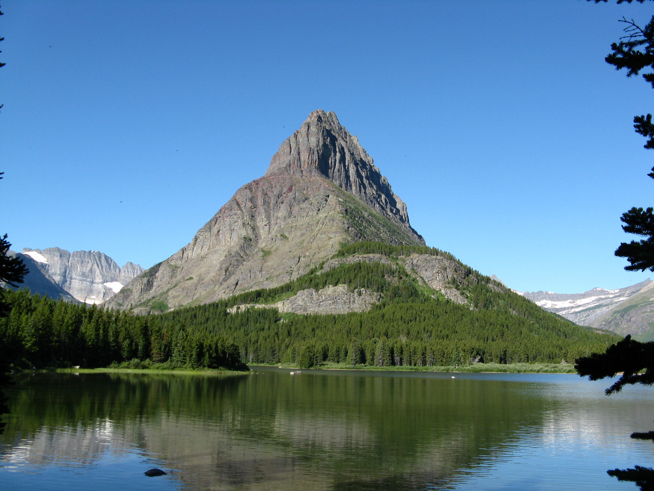Grinnell Point across Swiftcurrent Lake from the south shore trail, looking southwest.
