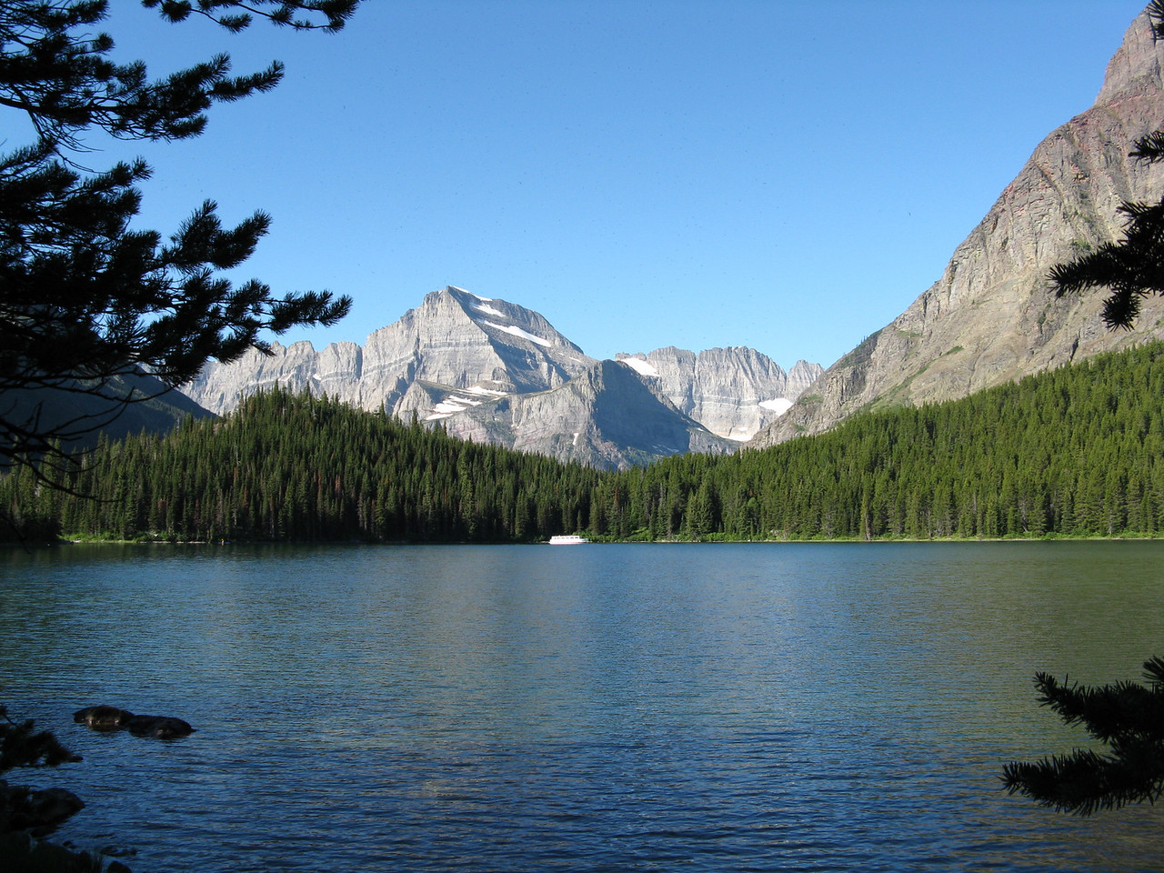 The boat reached the upper end of Swiftcurrent Lake while we were near the opposite end.