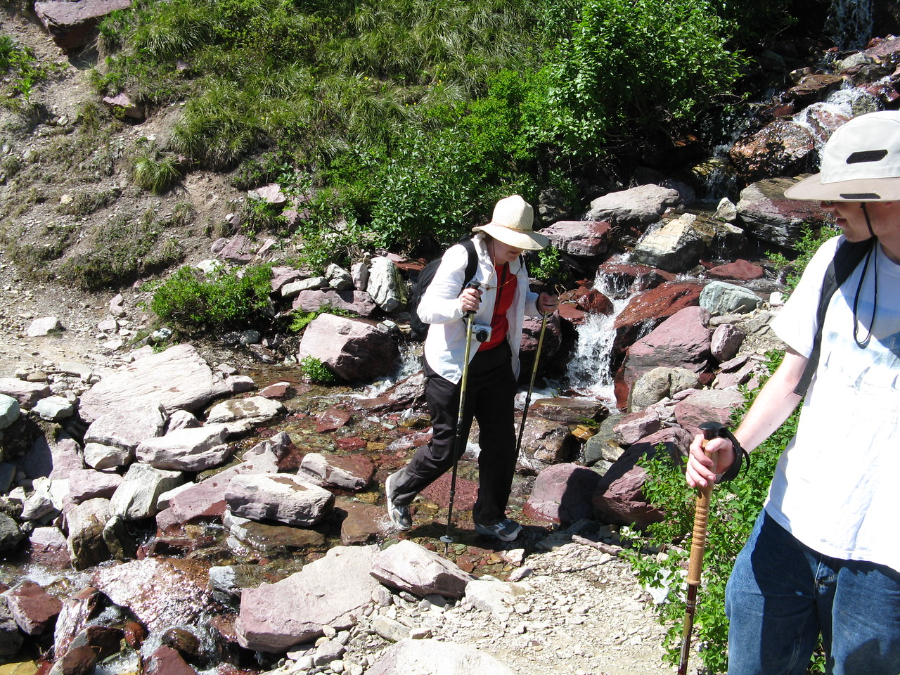 Mary crossing the creek.