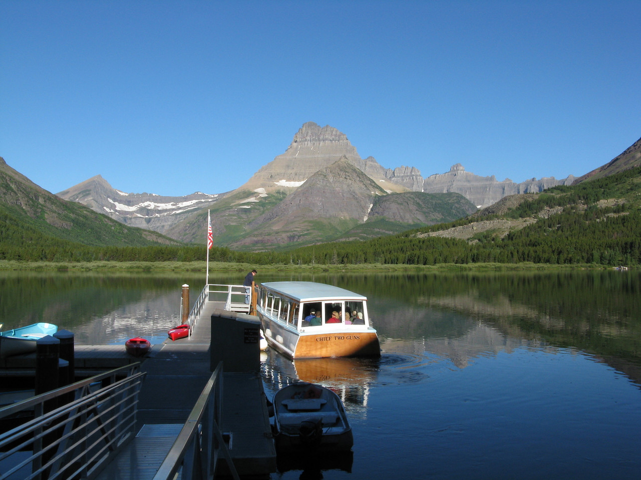 We arrived at the dock next to the Many Glacier Hotel in time to take the 8:30 a.m. boat.  The boat was full.  (The boat company had not returned my call for a reservation). So, we headed up the trail on foot.<br /> <br /> Looking west, this is Swiftcurrent Lake and Mount Wilbur in the distance.