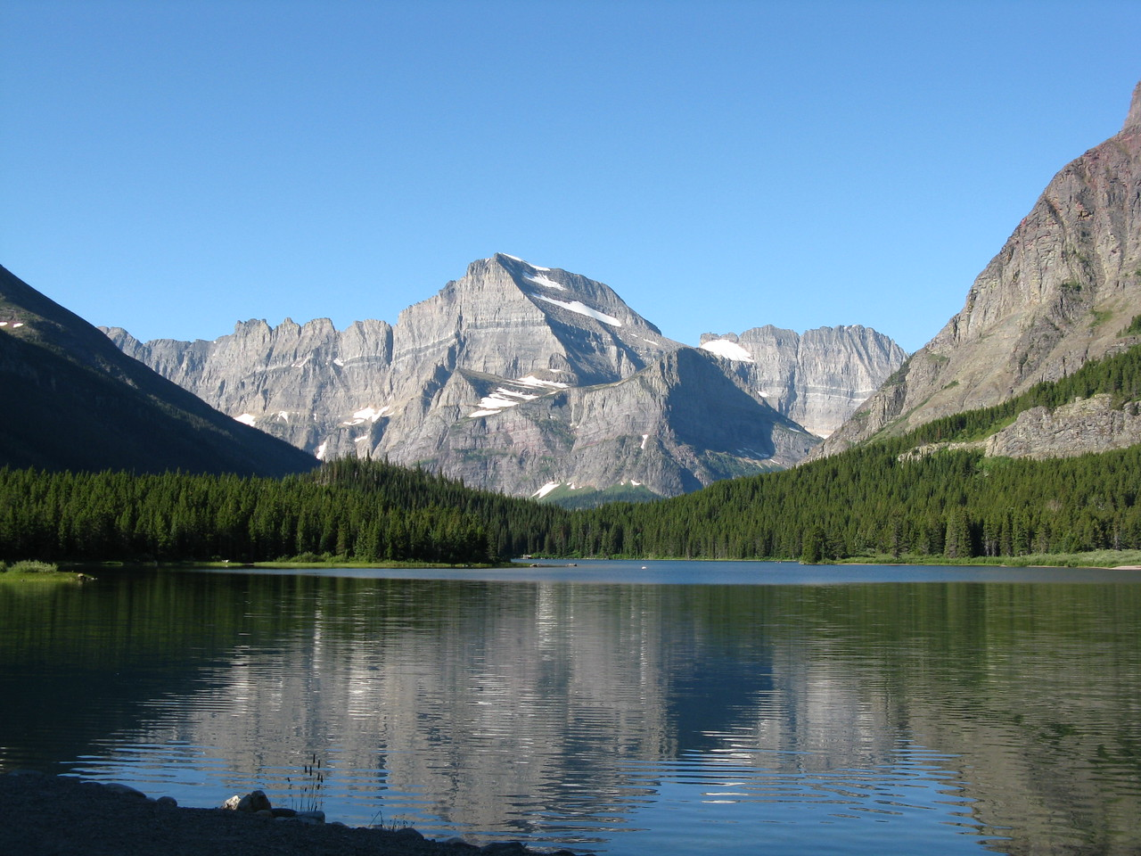 Mount Gould seen from in front of the Many Glacier Hotel on Swiftcurrent Lake, looking south- southwest.