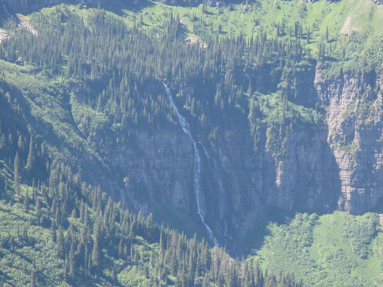 A telephoto view across the valley to Bird Woman Falls.