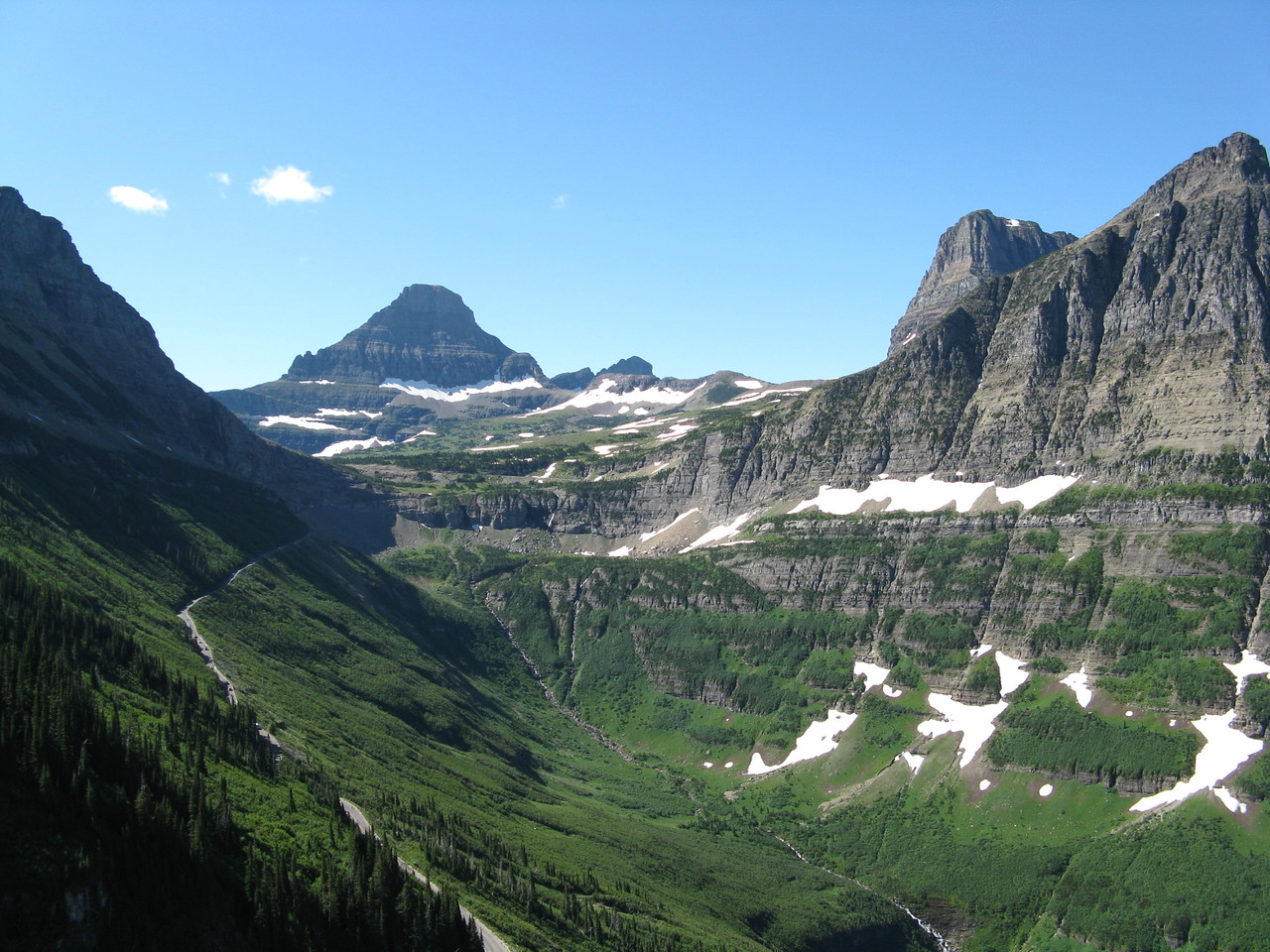 A look back at Clements Mountain and Logan Pass.  The Goint-to-the-Sun road is evident on the mountainside.