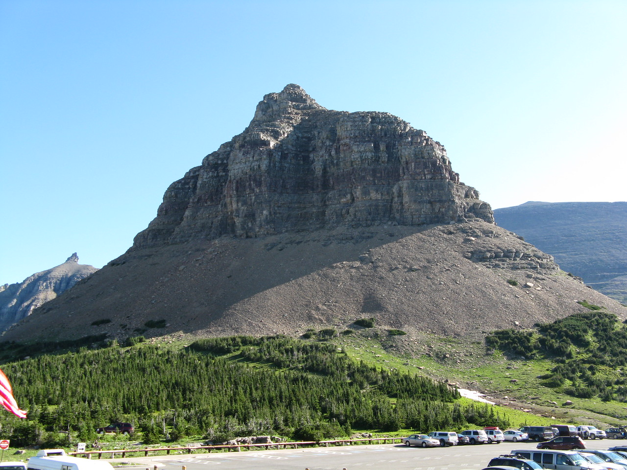 Looking across the Going-To-The-Sun Road and parking lot from the Visitor Center at the southern end of the Garden Wall at Logan Pass.