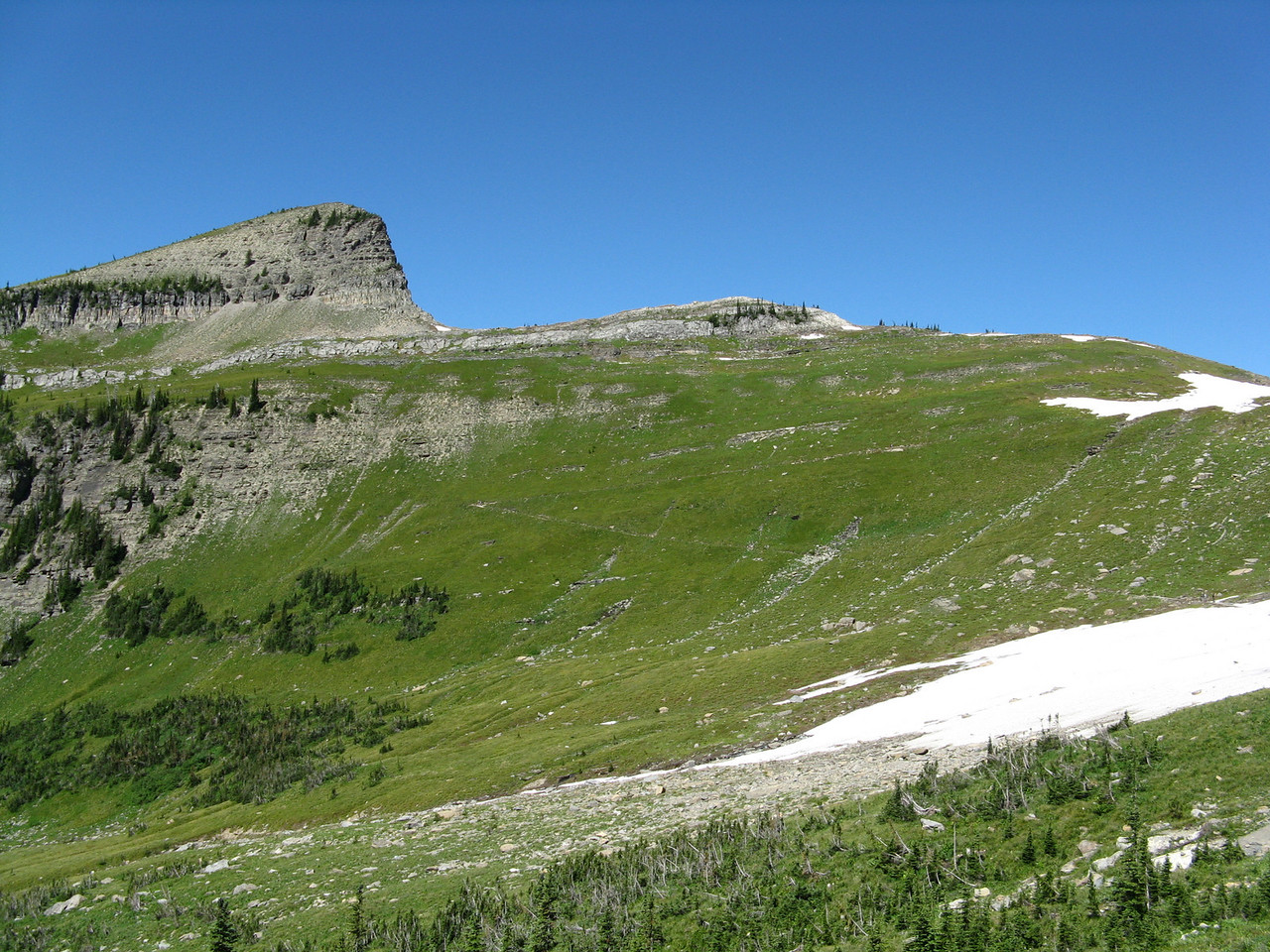 Haystack Butte from the trail.  The trail can be seen where it angles up the slope from the right to left center of the picture, then switches back to the snow field on the right upper part of the picture.