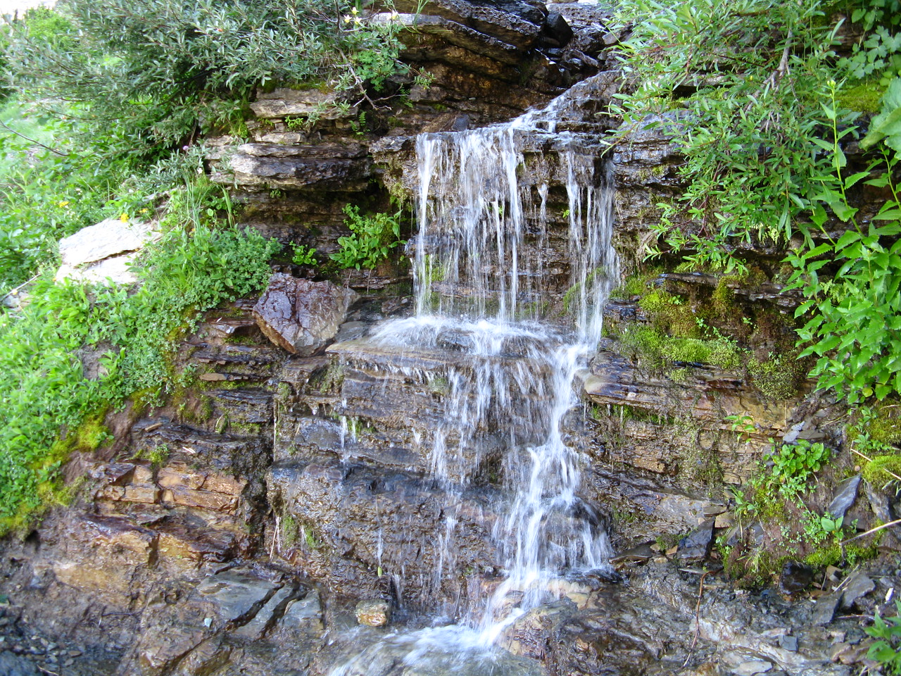 A waterfall next to the trail.