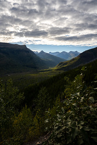 Cloudy Sun Lit View into Logan Creek Valley form the Going to the Sun road in Glacier National Park