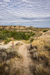 Trail and marker in the Painted Canyon in Theodore Roosevelt National Park
