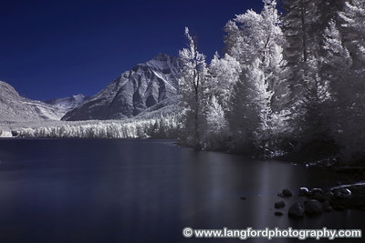 An infrared shot of Lake McDonald from behind the lodge.
