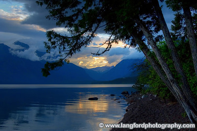 The early morning mist and clouds can create a very dramatic scene.  This was shot from a small beech at one of the many parking areas along Lake McDonald.