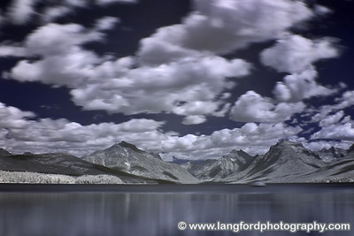 This is an infrared picture of Lake McDonald shot from near Apgar Village.  The clouds moving quickly through the scene add to the image.