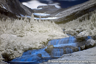 An infrared shot of one of the many waterfalls along the West side of Going to the Sun road. You'll need a wide angle lens to shoot the falls, as you end up being pretty close to them.