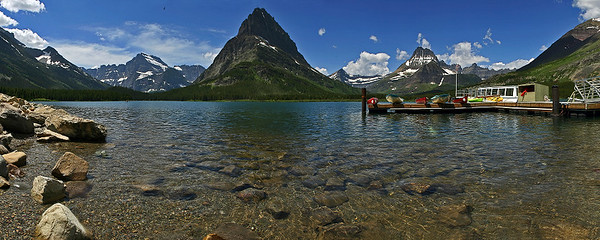 This panorama of Swiftcurrent Lake was taken near Many Glacier Lodge.  The large boat on the right will take you on a small tour of this lake, and Lake Josephine.  You can also rent out the canoes to cruise around by yourself.