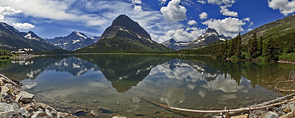 Panoramic image of Swiftcurrent Lake, with Many Glacier lodge in the distance. This was shot early in the morning after the sun had risen.