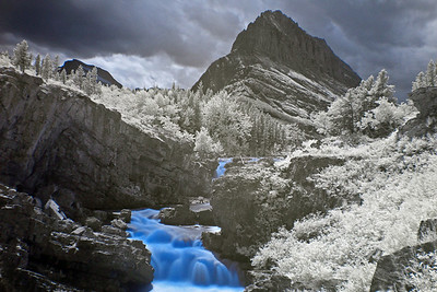 This is long Infrared exposure of swiftcurrent falls created by using a Hoya R72 IR filter.  These falls are quite dramatic, and are very near to Many Glacier Lodge.
