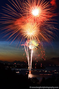 Every Fourth of July, many of the small towns around Flathead Lake launch impressive fireworks displays.  In this shot, the town of Lakeside is providing an amazing show.