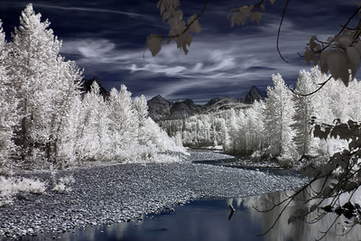 Infrared shot of the flathead river with the mountains of Glacier in the distance.  This was taken along Highway 2, which runs south of the park and connects East and West Glacier.