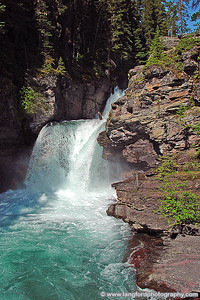 Picture of St Mary Falls. They are located along the trail around the West side of St Mary Lake. The trail can be reached by parking at any of the stops on the West side of the lake.  This shot is off of the trail near the bridge.