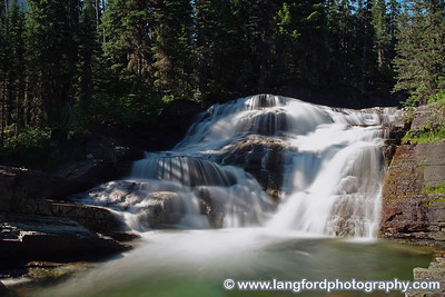 Long exposure of Virginia Falls.  Virginia Falls is along the trail around the West side of St Mary Lake.  The trail can be reached by parking at any of the stops on the West side of the lake.