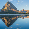 "Many Glacier Hotel on the bank of Swiftcurrent Lake reflection. The image is a panorama of several images and is optimized for a 20"" x 60"" print, I suggest metal."