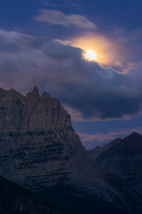 Moon Behind Clouds Over Logan Pass
