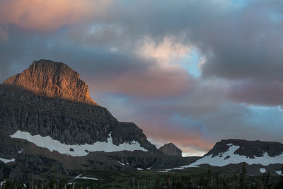 Dramatic clouds fill the sky as the sun sets near Logan Pass Visitor Center in Glacier National Park