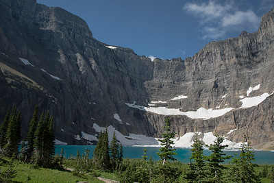 Iceberg Lake in Glacier National Park holds icy remnants well into the summer and typically into fall when the snow falls once more