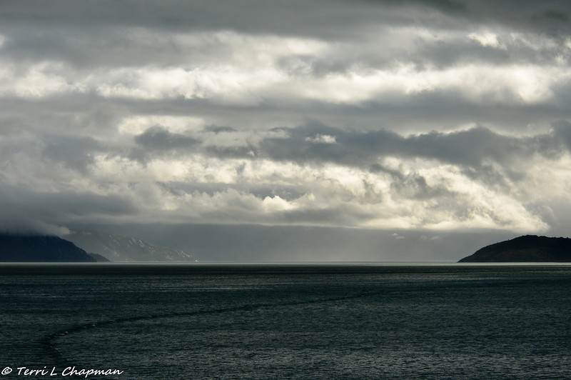 On the way to Glacier Bay, I thought it was going to be another day of rain, but the rain clouds began to  disperse and the sunlight was trying to come through. Hooray! We did get some good weather at Glacier Bay!