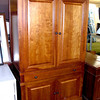 Entertainment Center/Armoire with Storage Drawers. Armoire has the appearance of maple with an auburn glaze finish 42 x 24 x 72.   <b>$450</b>