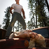 Models:Naomi Rebecca Young & Max Morin.<br /> In this photograph I made Naomi lay across the the hot hood of this old farm truck a 1947 Chevrolet pickup. With Max standing over Naomi I shot into the sun just behind Max's head to get a bit of sun flare.