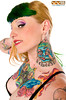 Side profile head shot of a heavily tattoed female side show performer