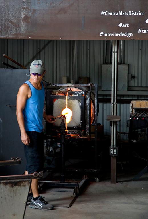 IMAGE: https://photos.smugmug.com/Glass-Blowing-Workshop/i-QbznkKd/0/4b5dc97f/XL/Glass%20Blowing%201-XL.jpg