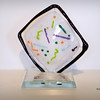 "<p></p> <h1 style=""margin:0px;""><font size=""4""><b>Eco Film Festival - Artist of the Year Award</b></font></h1> A glass sculpture representing an artist's canvas sits atop a glass base with an engraved aluminum plate.  <i><a href=""/Custom/Awards-and-Commissions/"" target=""_blank"" title=""Awards and Commissions - Kelly Lowe Glass."">Click here to go to the awards and commissions information page (link opens in a new window</a></i>  <i><a href=""/Glass/Awards/"" title=""Awards Sample Gallery"">If you are not on my main gallery of sample custom awards, click here to return there now</a></i>"